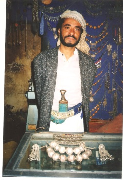 A jewellery maker in the old San'a market wearing his jambiya
