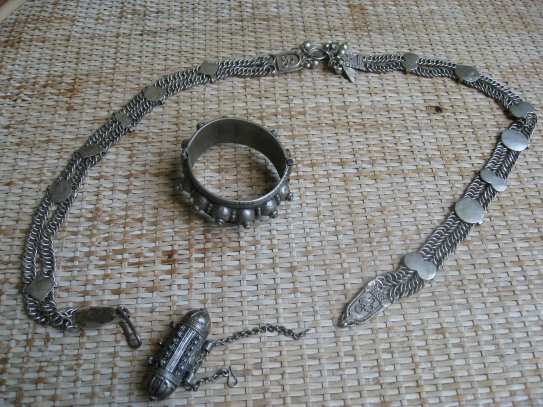 A belt, bracelet and a pendent used for holding the Koran. All are made from Jewish Silver.